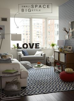 Small space, big style  Zig zag rug, wallpaper, giant letters, kid friendly family room.