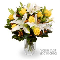 Joana - Making her the envy of the office has never been easier. Our Joana arrangement is a vision of creamy white and sunshine yellow, and boasts perfect roses and elegant Oriental lilies accompanied by lush foliage.