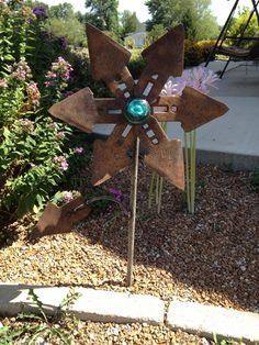 Rusty upcycled flower created with inspiration from Pinterest (and a little welding help from my dad)!