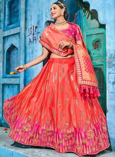 Hot Pink and Orange Art Silk Embroidered Lehenga an art silk blouse alongside an art silk lehenga with santoon inner. A banarsi silk jacquard dupatta completes the look. Embroidery work is completed with thread, zari and stone embellishments. Lehenga Choli Wedding, Lehenga Gown, Pink Lehenga, Lehenga Choli Online, Banarasi Lehenga, Half Saree Designs, Choli Designs, Lehenga Designs, Indian Wedding Wear