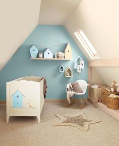 Simple blue baby nursery room with wooden miniature houses. #KBHome