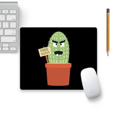 Now available on our store: Angry Cactus With.... Check it our here! http://www.colorpur.com/products/angry-cactus-with-free-hugs-mouse-pad-black-base-artist-torben?utm_campaign=social_autopilot&utm_source=pin&utm_medium=pin