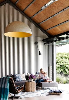 The owner opted for a hangar door in place of sliding or concertina doors, an unusual feature with added benefits.Photo: Maree Homer | Styling: Louise Bickle | Story: Australian House & Garden