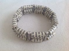 Book page paper bead bracelet by MagdaCrafts on Etsy, £14.00