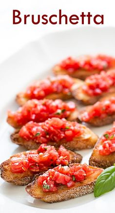 BEST bruschetta ever! WIth chopped fresh tomatoes with garlic, basil, olive oil, and vinegar, served on toasted slices of French or Italian bread. #healthy #vegan On SimplyRecipes.com