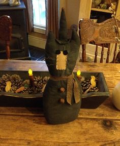 Primitive black cat with witches hat