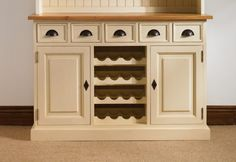 Mottisfont Painted Dresser Base With Built In Wine Rack MDR602BA lovely painted dresser base in either cream, blue, green or white with a choice of pine or solid Oak top. Should you require an alteration i.e. another cupboard instead of the wine rack please let us know and we will provide a quote.Material: Pine and Oak Style: Country Height: 850 mmWidth: 1250 mmDepth: 500 mm