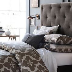 gray & white bedroom with tufted headboard