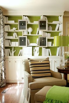 Lime green background with white bookcase and white accessories.  The black art work grounds the design