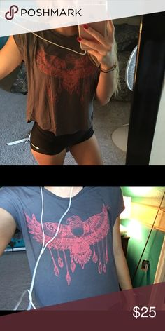 Super Cute Never Worn Loose Shirt. This super cute shirt that's never been worn is super soft! It's a grey shirt with a red/pink eagle on the front with a pocket on the top left corner. It's super comfy and loose. It's a size small (: PacSun Tops Tees - Short Sleeve
