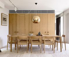 Built-in cabinets. Light fixture. Dining table & chairs. I want a pop of color in there.