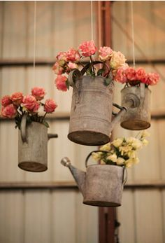 flowers in hanging watering cans