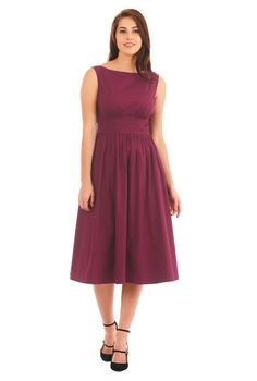 Trapunto lines at the wide banded empire waist texture our flattering fit-and-flare dress tailored in stretch cotton poplin with ruched pleating at the bodice and skirt.