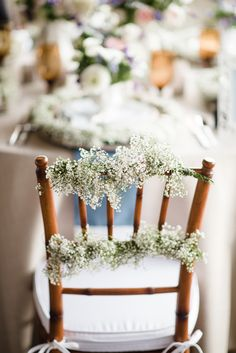 baby's breath wedding decor, photo by Emily Millay Photography http://ruffledblog.com/nautical-romance-wedding-ideas-in-charleston #babysbreath #chairswag