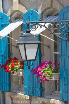 Exuberantly blue and flowered pair of shutters and windows in Arles, France Color Splash, Belle France, Flower Boxes, Flowers, French Countryside, Street Lamp, Window Boxes, Windows And Doors, Big Windows