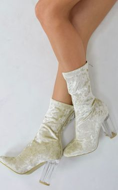 Yes baby she's got it! up your autumn winter shoe game in these amazing ankle boots featuring a luxurious crushed velvet design, and statement perspex heel.