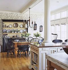 This is a great idea to overcome the issue of a support beam when open-concept is the design choice.  Instead of installing a non-functional support post, these homeowners incorporated the support right into the countertop area!  The base cabinet would have to be engineered to support the weight from above but an open-concept has been achieved!  BHG