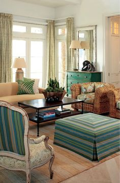 Turquoise cabinet, skirted ottoman, mixed fabric on chair