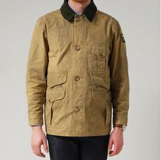Khaki canvas jacket with contrast collar, Filson.  Note the many pocket flaps.