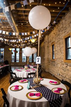 Tables - large balloon into bowl of candy. Flag bunting & twinkle lights -  Balloon Wedding Décor Ideas: 10 Fun Ways to Incorporate Balloons Into Your Big Day - Wedding Party