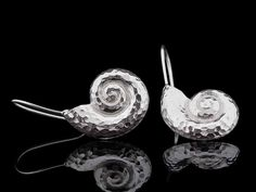 These handmade earrings feature the Golden Ratio also known as the Fibonacci Spiral. Handcrafted Jewelry, Earrings Handmade, Fibonacci Spiral, Open Backs, Golden Ratio, Concave, Ear Studs, Earring Set, Silver Earrings
