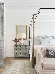 A beautifully distressed door leads to the master bedroom, where a graceful canopy bed makes the most of the soaring ceiling. Photo by Julie Soefer. Design Room, Home Bedroom, Bedroom Decor, Bedroom Furniture, Bedroom Mirrors, Canopy Bedroom, Canopy Beds, Bedroom Lighting, Master Bedrooms