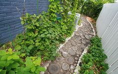 This wood-slice garden pathway is a clever, rustic solution for extra firewood.
