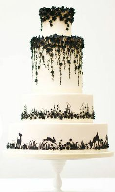 Insanely intricate black and white wedding cake..... aboslutely love the piping on this!