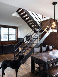 The dark wood dining table and chairs are just absolutely to die for! Love the stairs as well
