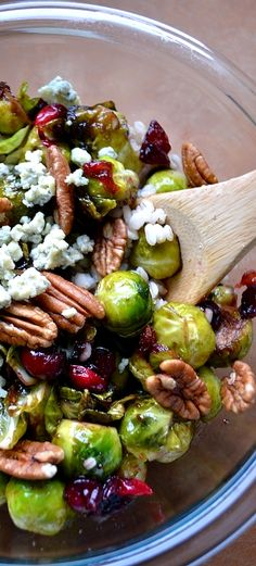Pan-seared brussels sprouts with barley, cranberries, pecans, maple syrup, balsamic vinegar, and olive oil. Salt & pepper to taste. Top with gorgonzola . . .