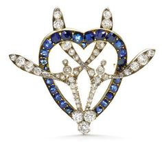 A diamond and sapphire brooch, c.1900, by Fabergé, in the form of an intertwined mistletoe sprig and love heart. (artnet.com)