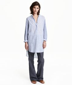 Tunic in woven cotton fabric with narrow stripes. Low stand-up collar, button placket, long sleeves with buttons at cuffs, and slits at sides. Slightly longer at back. - Visit hm.com to see more.