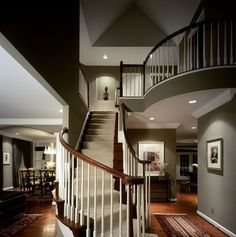 Love the curve of the balcony and stairs!  Love the color!