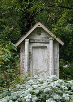 Charming potting shed made from old pillars, doors and other architectural salvaged materials