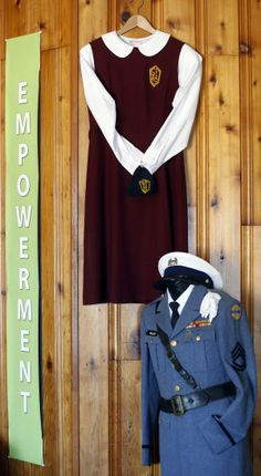 Old student uniforms from the St. Francis and St. Emma schools hang in a display at Belmead.