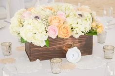 Flower center piece incorporating variety of color and different flowers, in a wooden box, bohemian style At Key Largo Lighthouse Beach Wedding Venue in the Florida Keys