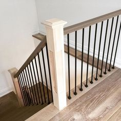 Shaker/Craftsman wood rail cap with iron balusters and square shaker posts