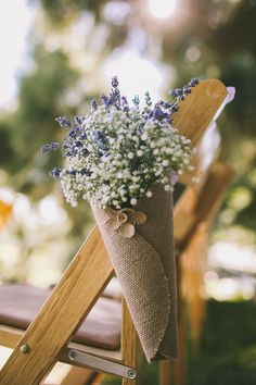 Ready to plan the rustic/vintage wedding of your dreams on a reasonable budget? I am selling all of the decorations from my wedding in the hope of making someone else's wedding just as beautiful. My aunt made these beautiful burlap cones filled with dried lavender and baby's breath. They have white satin ribbons attached to them so they can be tied to the sides of ceremony chairs.