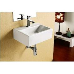 Elanti White Wall-mount Rectangular Bathroom Sink at Lowe's. Features a smooth white porcelain make and clean cut rectangular design to provide a simplistic yet beautiful addition to your kitchen or bathroom space. Neo Angle Shower Enclosures, Wall Mounted Sink, White Walls, Sink, Bathroom Sink, Small Bathroom Solutions, Wall Mounted Bathroom Sinks, White Vessel Sink, Rectangular Sink Bathroom