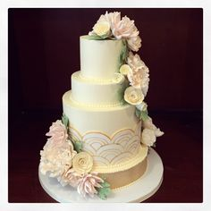 Just a classic art deco wedding cake with sugar flowers. Congratulations to Amanda and AJ! Hope you enjoy all of your flavor combinations!! (They went a little nuts at their tasting party and we love them for it...) Photo by Sugar Flower Cake Shop. www.sugarflowercakeshop.com