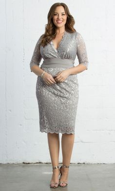 Illuminate your wardrobe in our Plus Size Lumiere Lace Dress. Scalloped metallic lace flatters your curves, while a solid ruched waistband draws the eye inward.