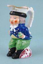 Antique Staffordshire porcelain 'Paul Pry' miniature Toby Jug.