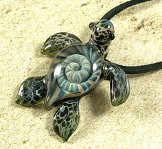 This Ocean Nautilus baby sea turtle pendant is a piece of custom jewelry handmade by myself Ryan Jessee. All of my lampwork glass beads are made with first quality colored borosilicate glass. My artwork is the expression of the beauty I see in nature, and created to be a wearable