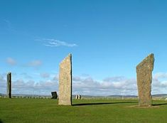 """""""Even in daylight the place has something uncanny about it. The Standing Stones o' Stenness, mouldering, scarred and grey with age, rising as they do from an unbroken bed of heather always have a weird mysterious appearance."""" ... Orkney Isles via the John O'Groats ferries... This henge monument was carbon dated back to 3100 bc... WOW"""