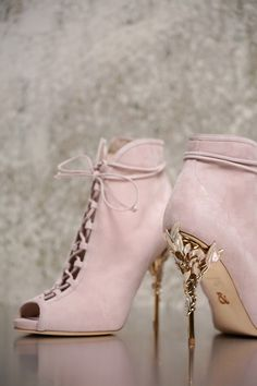<p>With ornamental filigree leaves spiralling naturally up the heel, this Baby Pink Suede Eden Open Toe Ankle Boot harks back to the beauty and perfection of a lost paradise. As if from an enchanted fairy-tale, entangled in the dense foliage of the forest and claimed by a wandering damsel, the Eden Ankle Boot is celestial, refined and romantic.</p> <p>The Eden Open Toe Ankle Boot is part of an exclusive preview of our new accessories collection, as featured in the AW16/17 Couture Show. For…