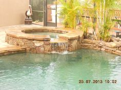 Natural Rock Spa #11 | Uni-Scape Waterfalls, Natural Stone Work, Ponds, Swimming Pool and Spa Renovation, Flagstone Patios and Outdoor Kitchens.