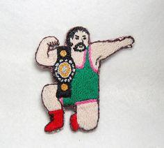 プロレスラーを刺繍したブローチです。土台はフエルトです。|ハンドメイド、手作り、手仕事品の通販・販売・購入ならCreema。