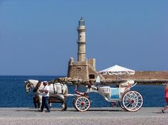Chania Town, Greece: Chania lighthouse with livery carriage