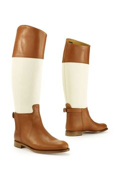 Ralph Lauren Riding Boot: Crafted from hand-burnished calfskin and cotton canvas, this equestrian-inspired, two-toned boot is made in Italy and features sleek pull-on styling