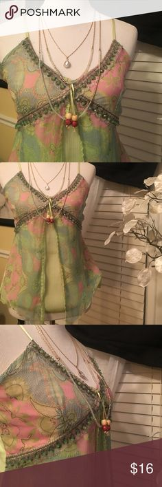 Merchant tank top Gorgeously made , beautiful design , finest materials 100% silk and 100% cotton , it's in excellent condition and adorable! Mechant Tops Tank Tops